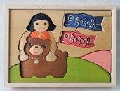 手作りの木工パズル金太郎とクマ